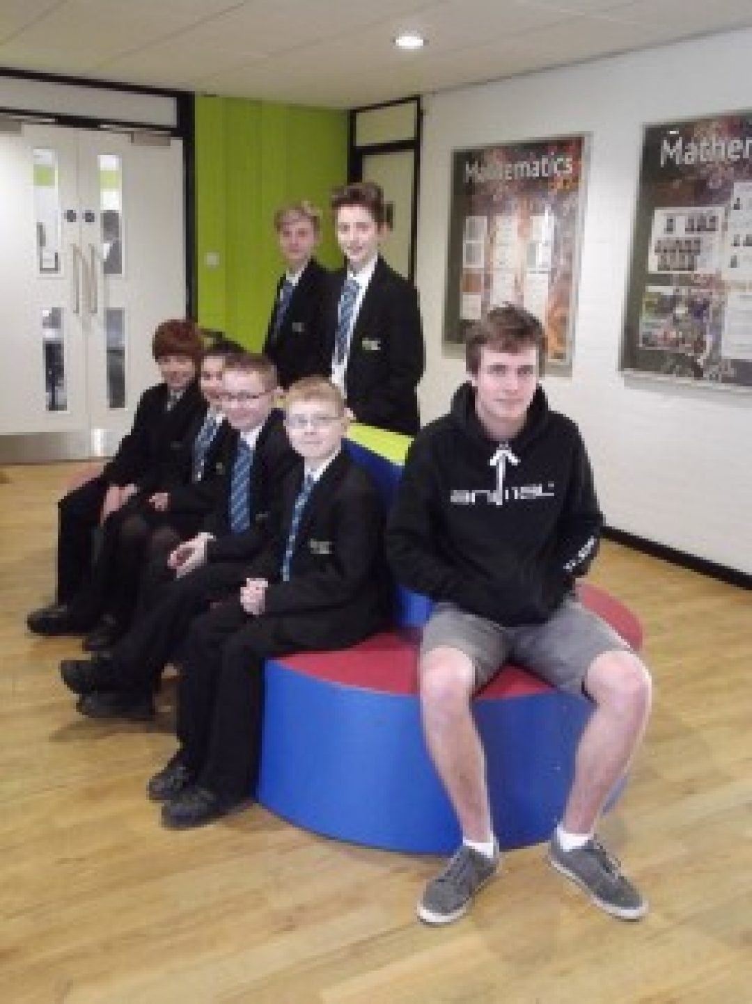 James Groves (far right) sat with a group of Year 7s on his newly installed seat
