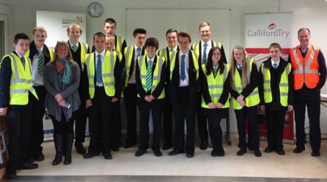 Mark Mullen from GallifordTry (pictured in an orange hi-vis vest) with Newton Abbot College students