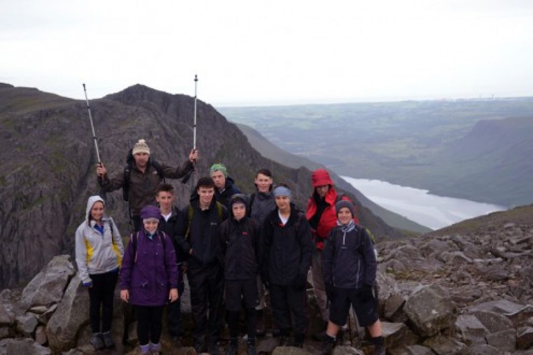 The team at the summit of Scafell Pike, England.