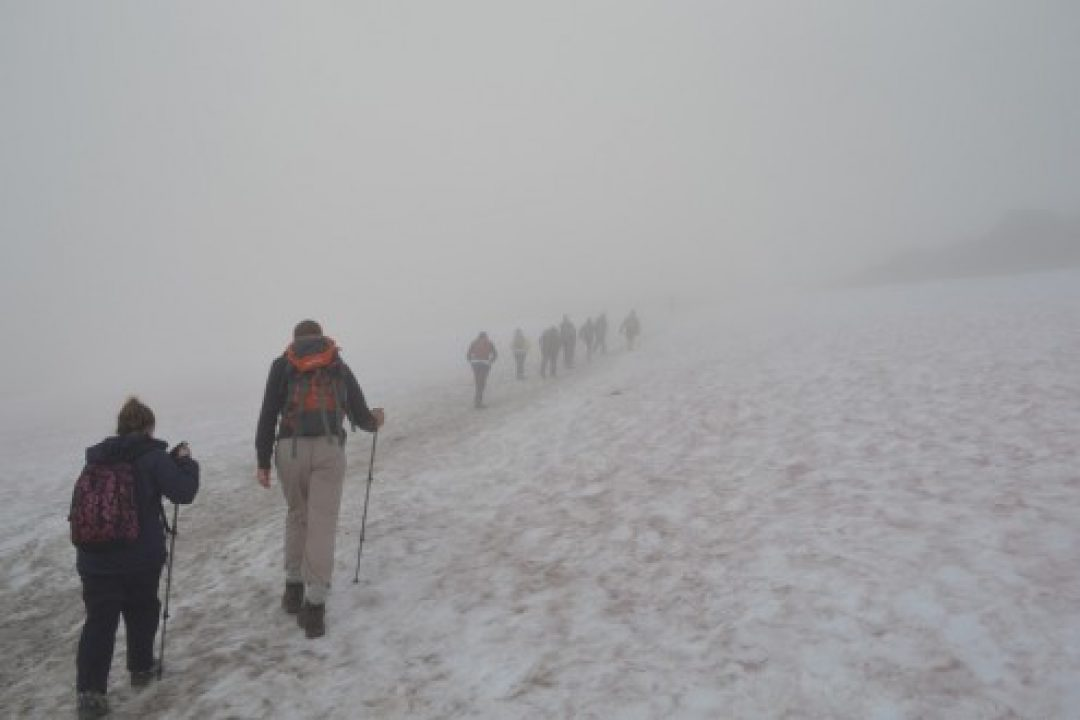The team walking through the snow as they approached the summit of Ben Nevis, Scotland.