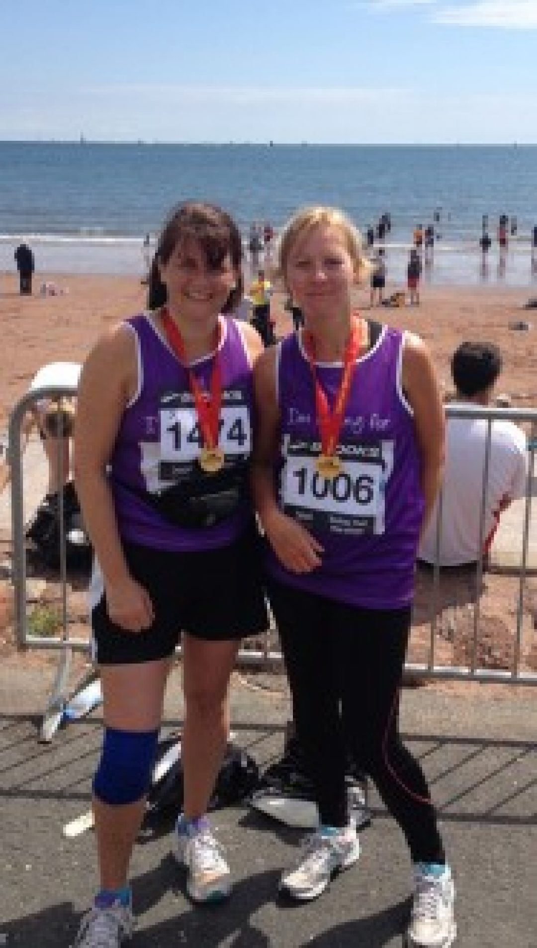 Joni and Julie sporting their medals