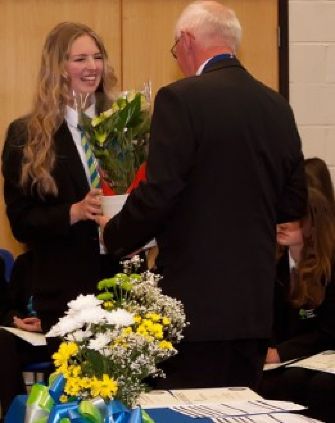 Amber Mold, winner of the Principal's Prize, being presented with a plant by Michael Ryan, Deputy Mayor of Newton Abbot