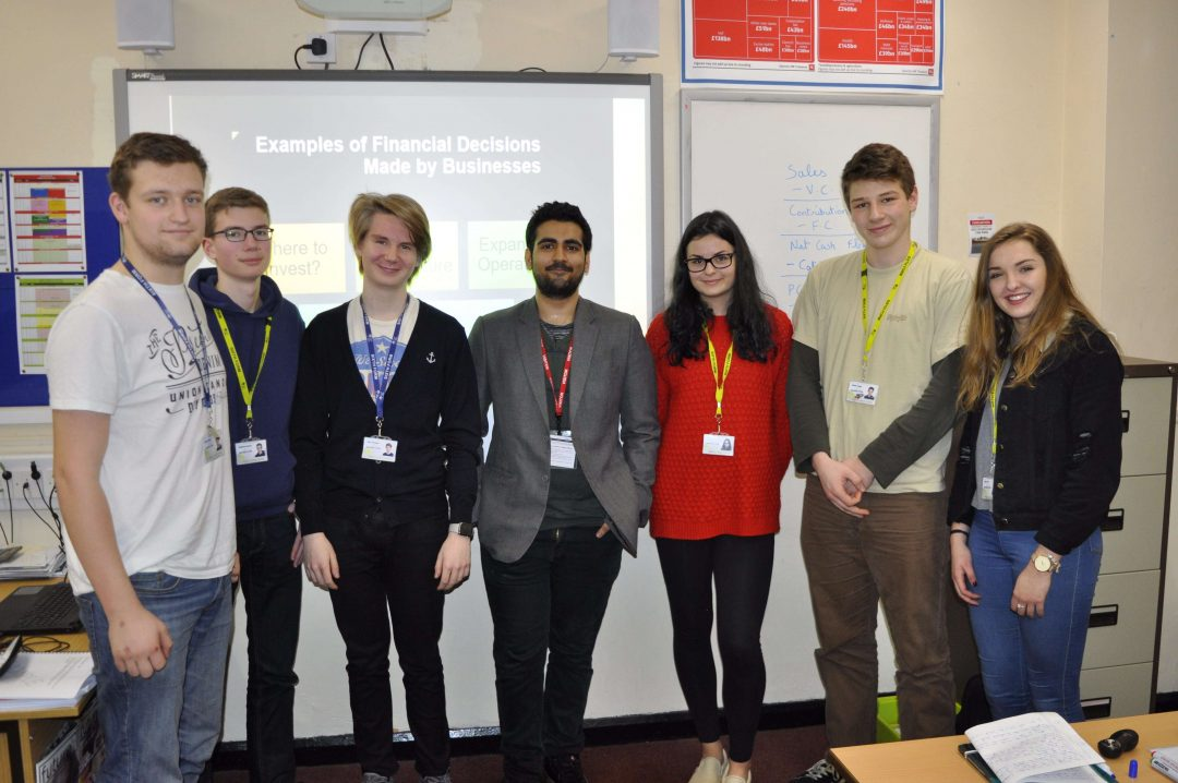 Vinayak (centre) with some of the College's Year 12 Business students