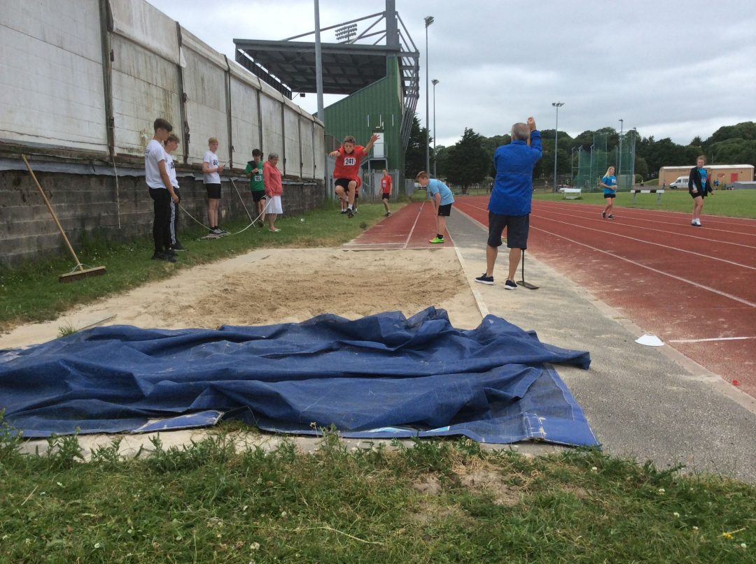 Students competed in track and field events including long jump
