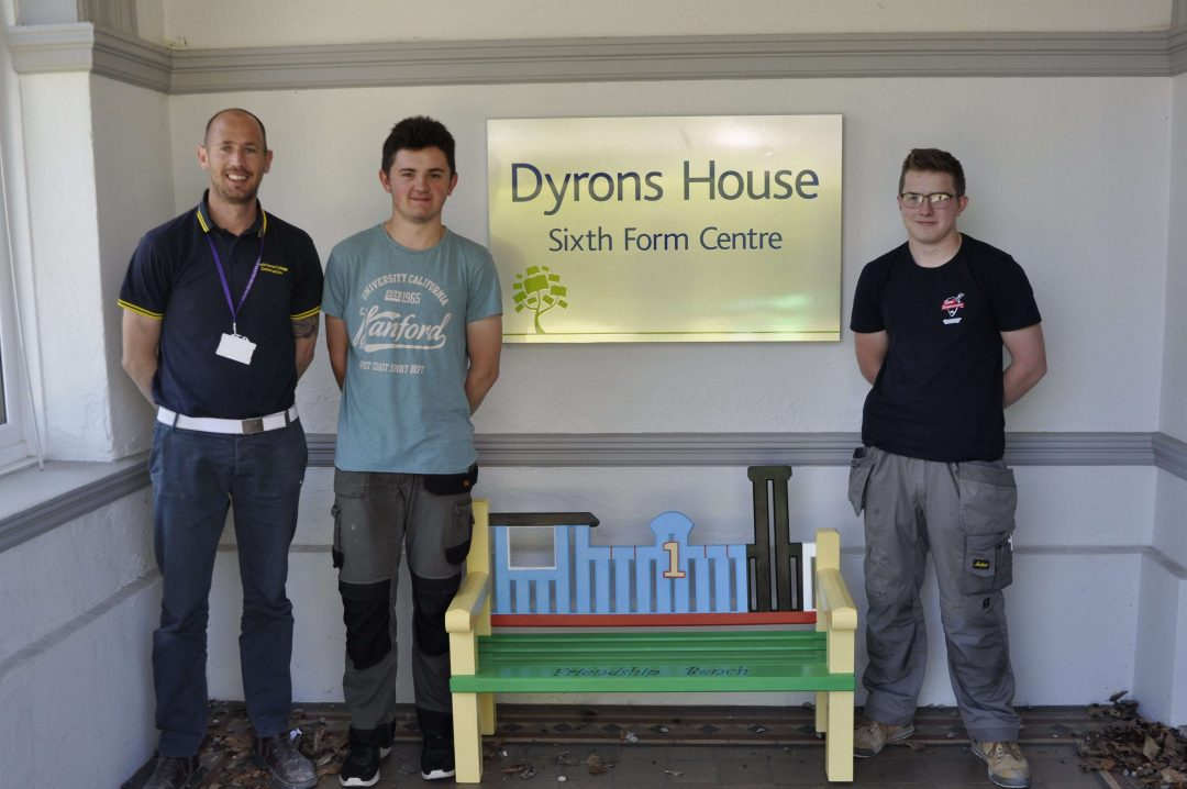 Paul Robbins, Sam Morgan and Ben Geary with the Friendship Bench