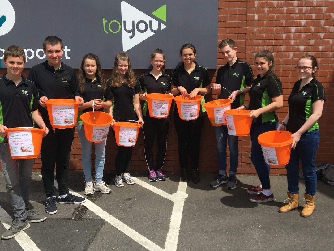 Volunteer students packed bags at ASDA