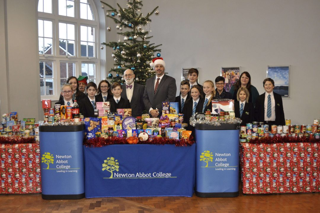Roger Beech from THAT Place (Back Centre) receiving the annual Christmas Food Bank Donation