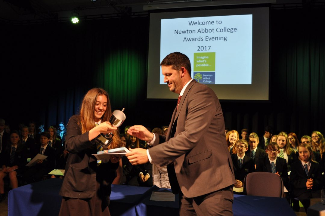 Libby Evans receiving the Principal's Prize from Mr Cornish