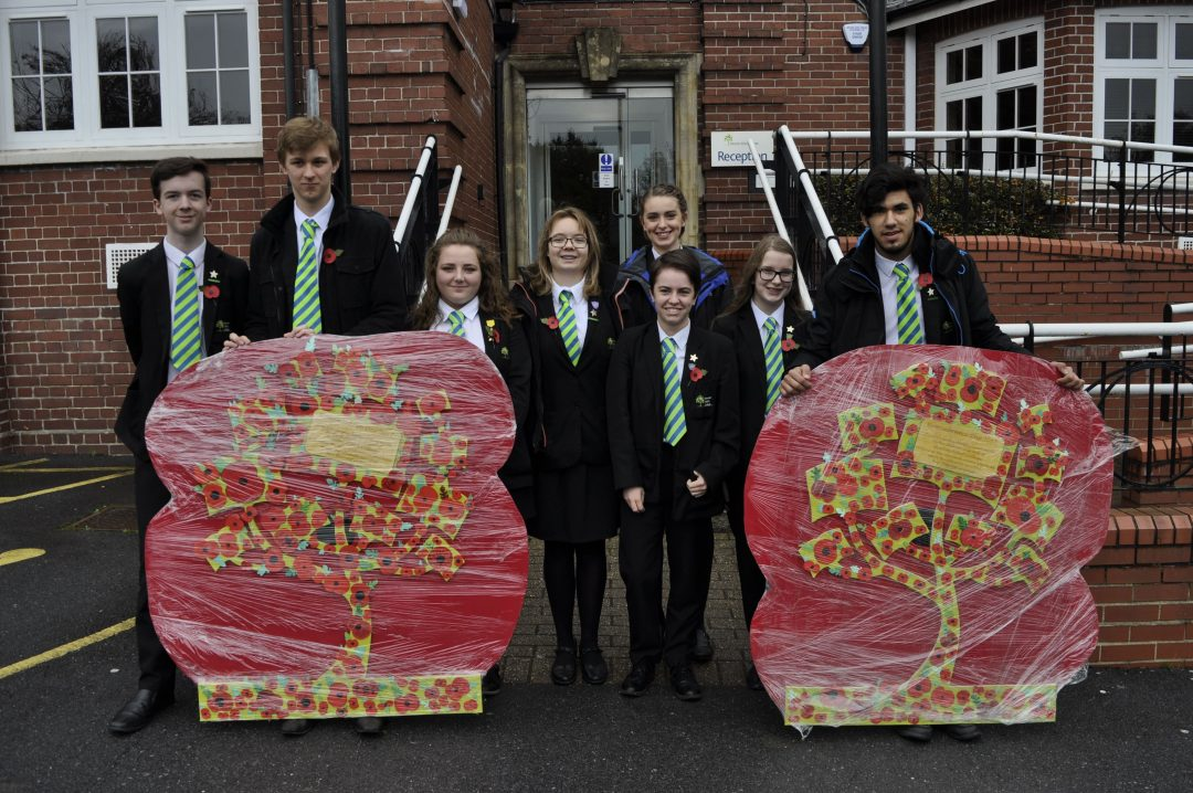 Prefects walked the poppy trees through the town on November 11
