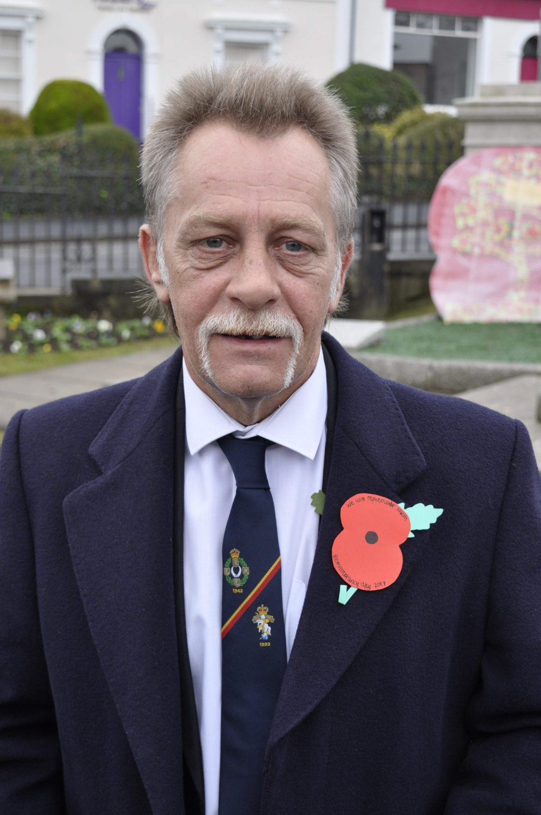 Head of House, Colin Gill, sporting a student-made poppy
