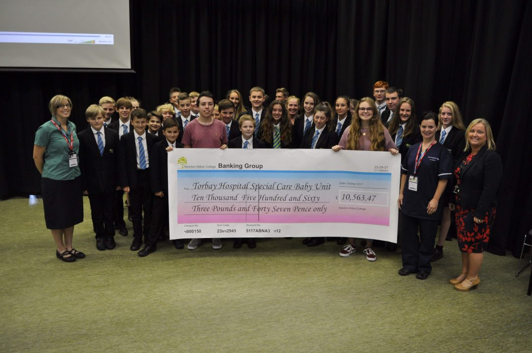 Staff and Students presented Torbay SCBU representatives with the record-breaking cheque