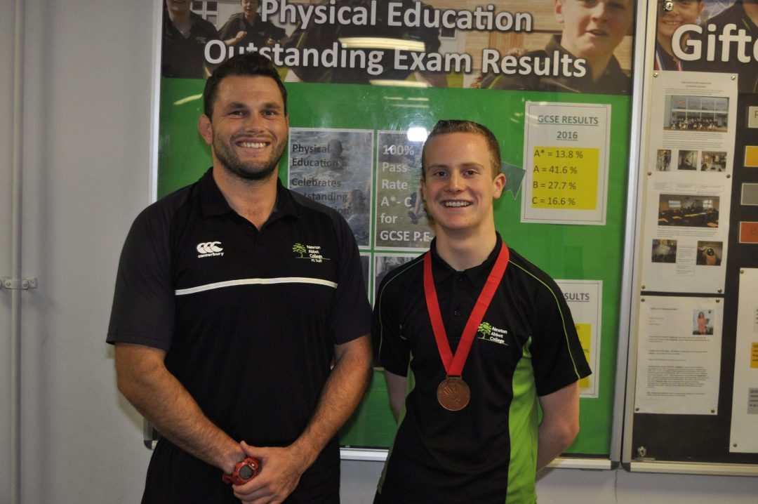 Head of the Physical Education Department, Jamie Salter and Zak-Ray with his bronze medal
