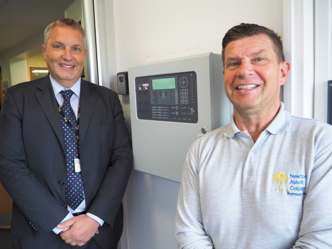 Business Manager, Nick Hill (L) with Premises Manager Ray Busko and the new alarm system control hub