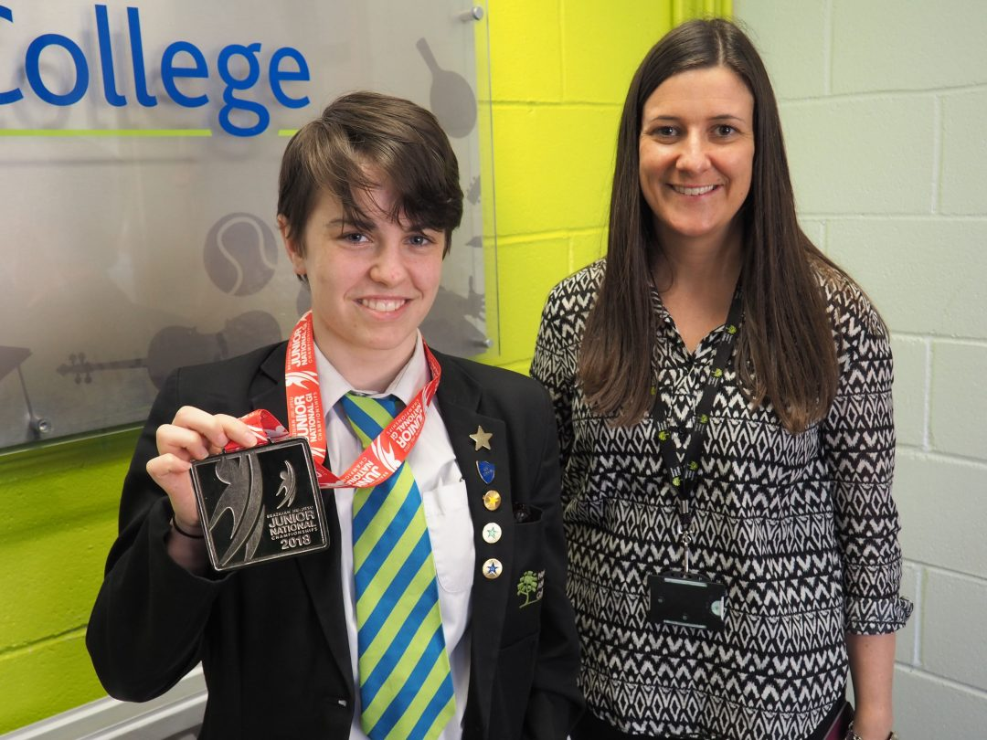 Willow with her medal and tutor, Hannah Brown