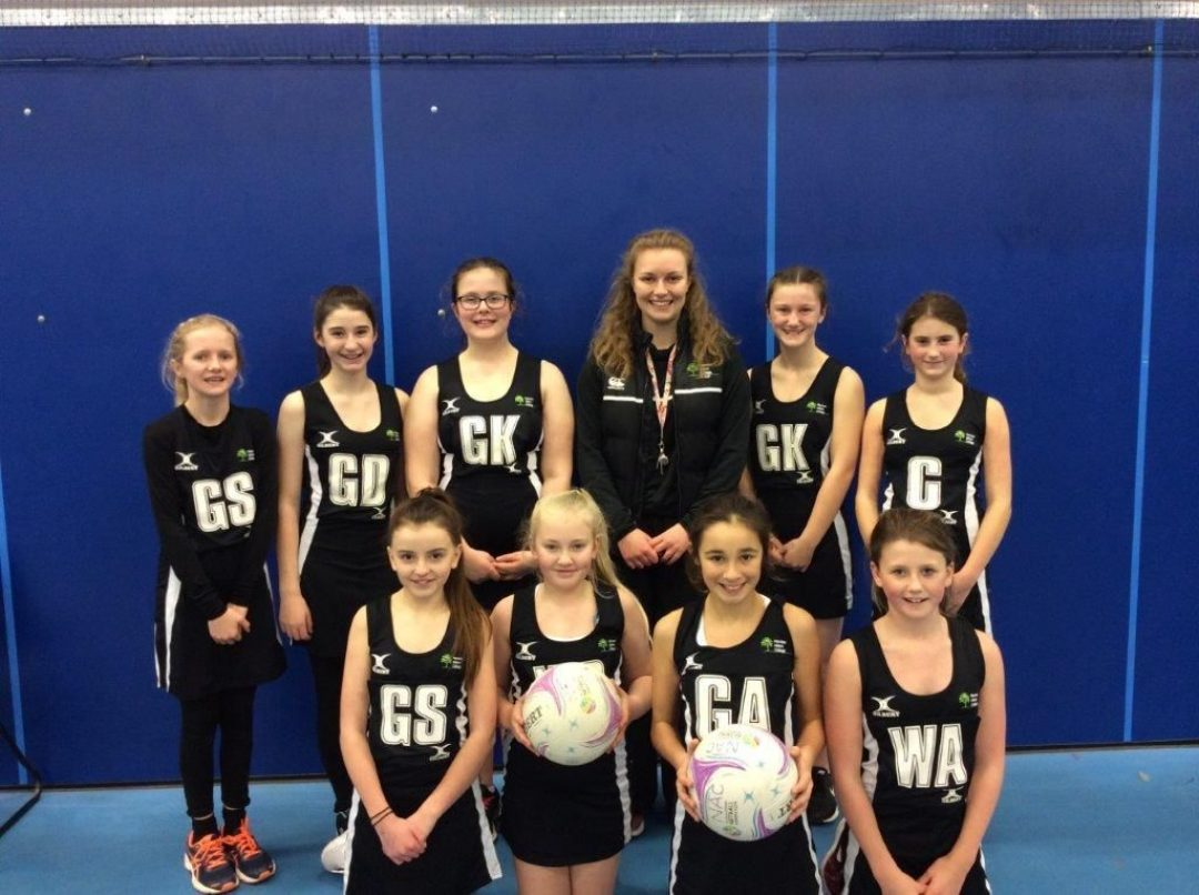 The Year 7 Netball Team with Teacher of Physical Education, Charlotte Tonge
