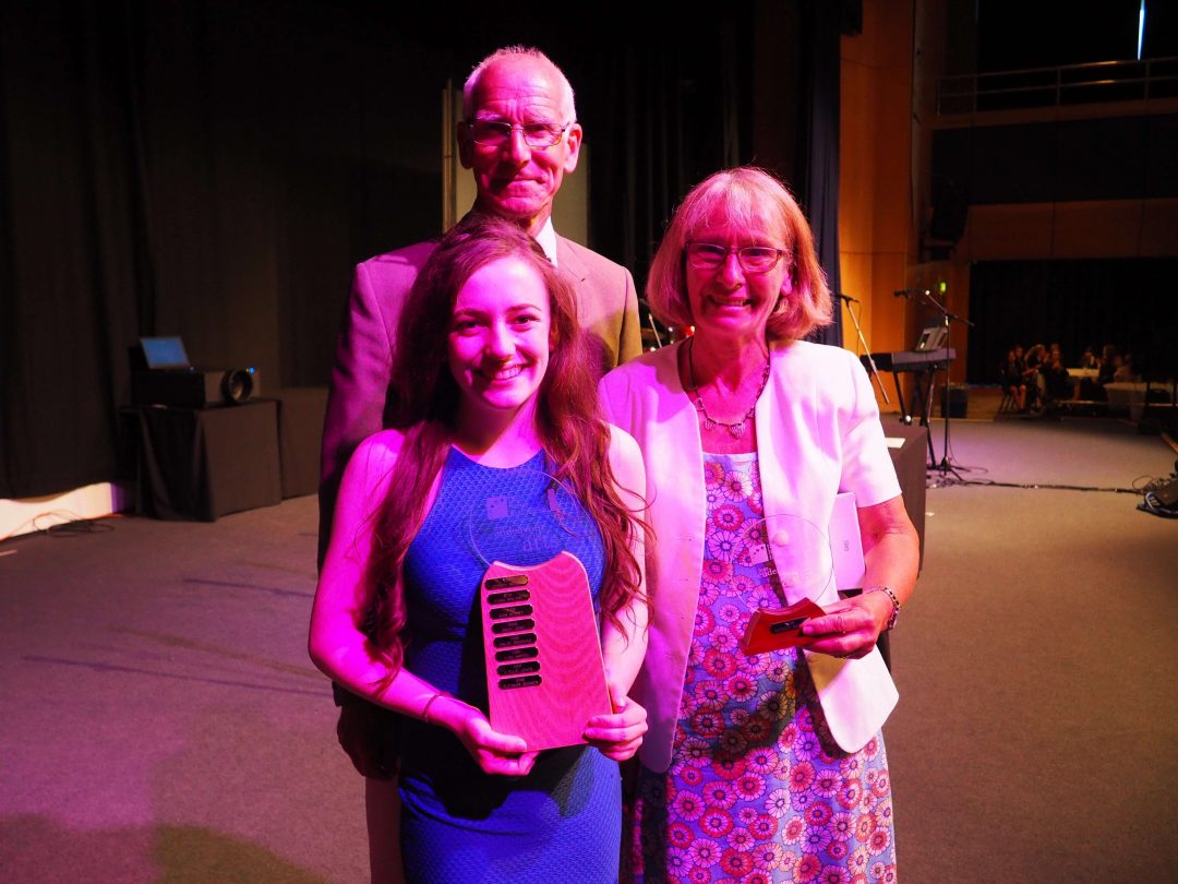 Year 11 student, Eleanor Skinner, receiving The Helen Foundation Award from Roger and Annie Kirk