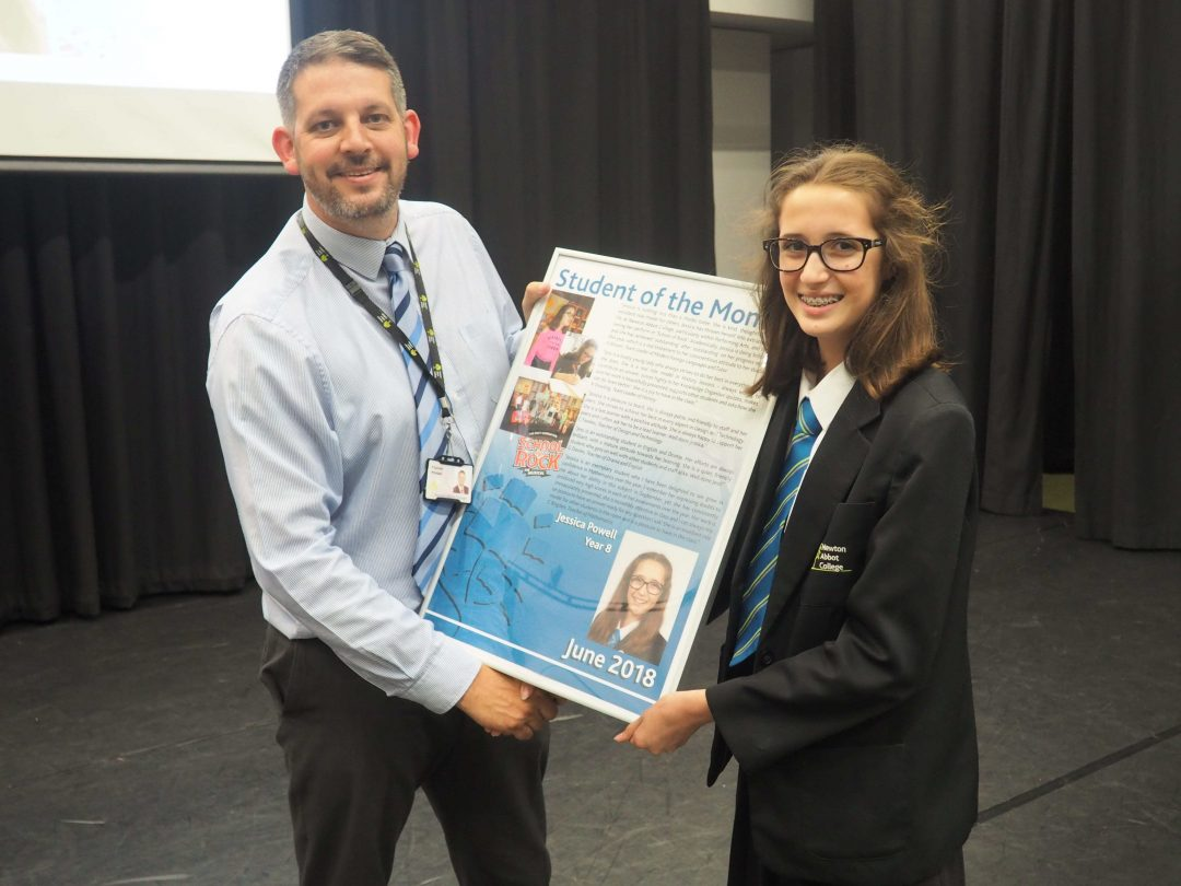 Jessica receiving her award from Mr Cornish
