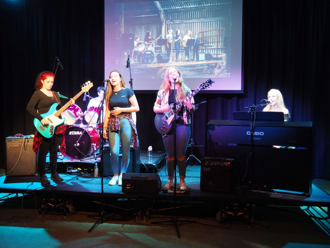 'Then There Were Six' performing in their final College show