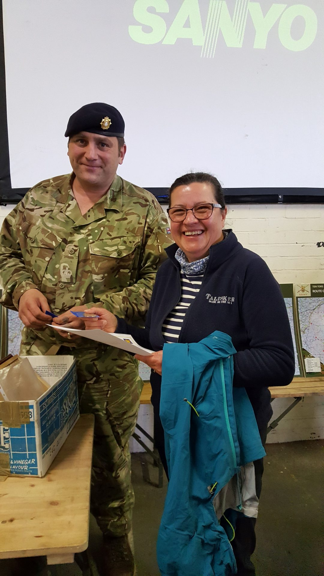 Lyndsay Cooper receiving her Gold Award from Ten Tors Event Director, Colonel APL Dawes