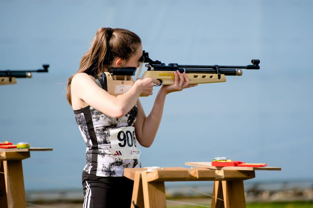 Erin shooting during the competition