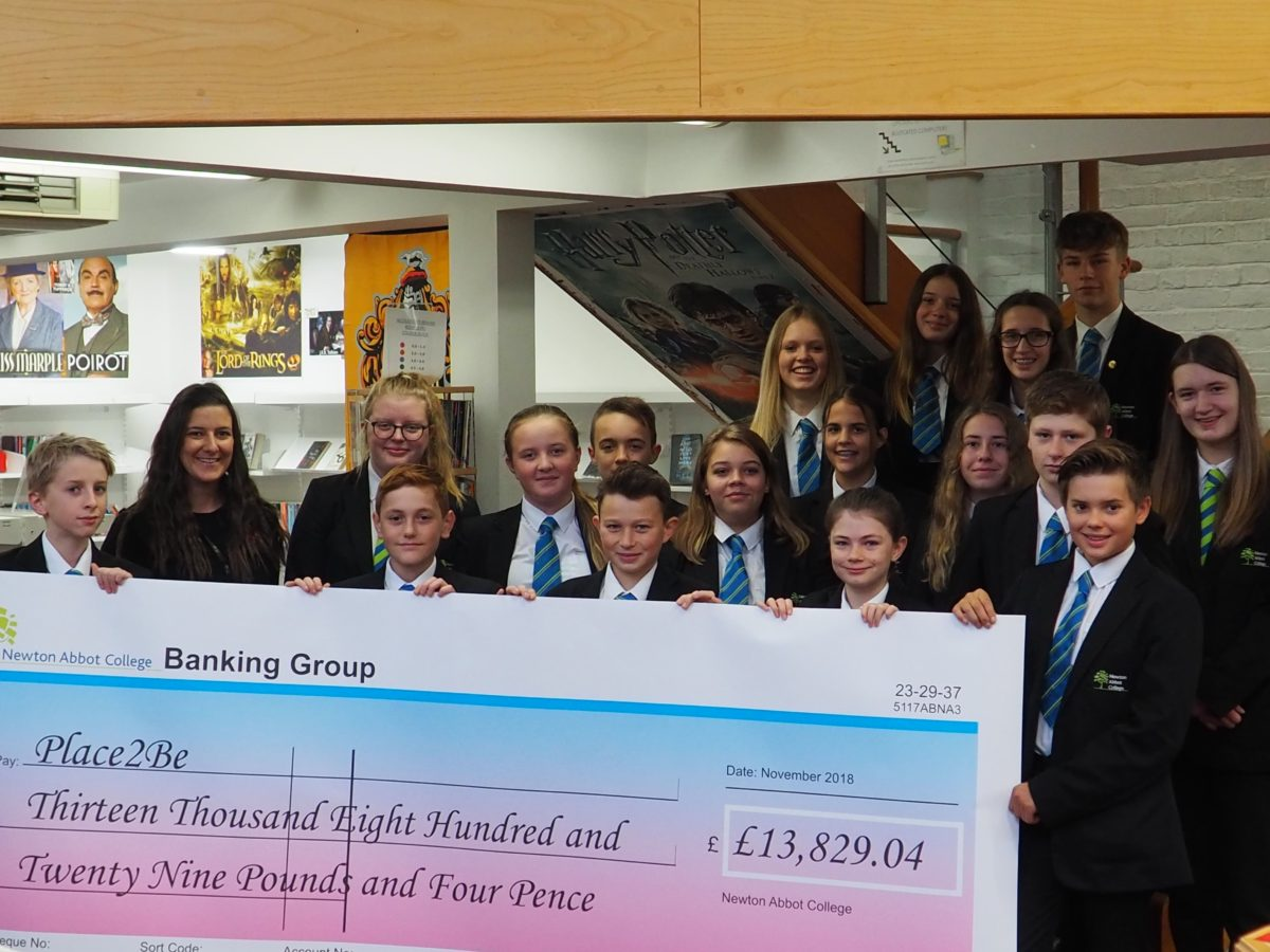 The College's highest fundraising tutor group, T6 with the cheque