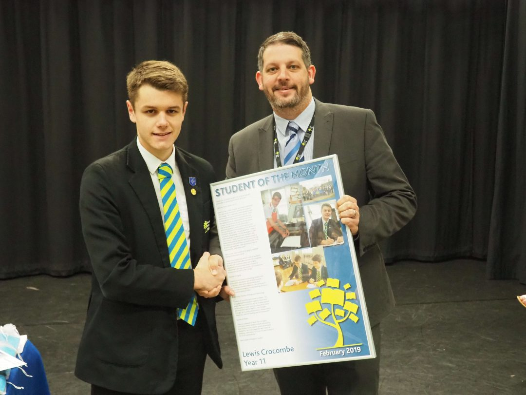 Lewis receiving his award from Mr Cornish