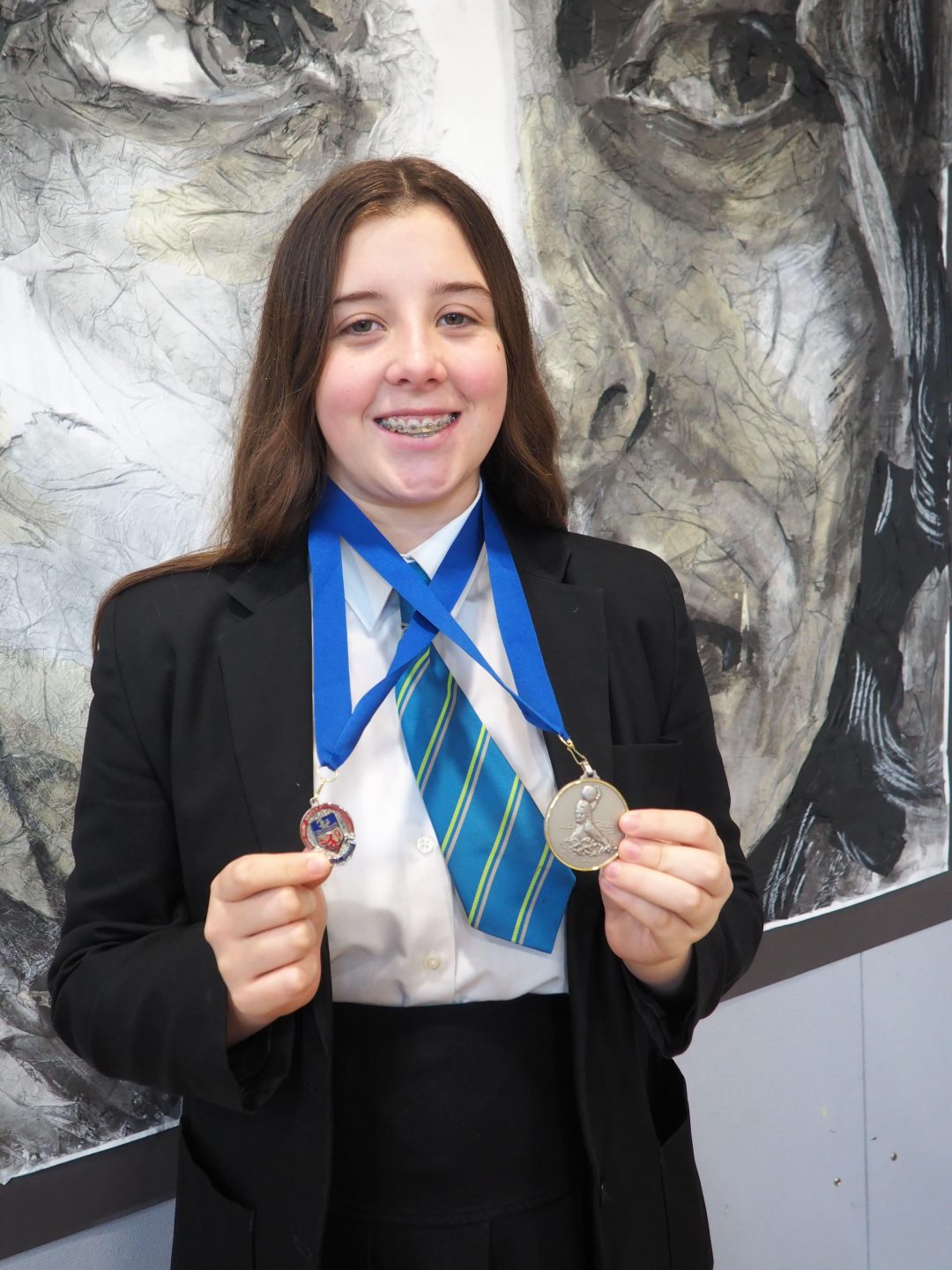 Sophie with her medals