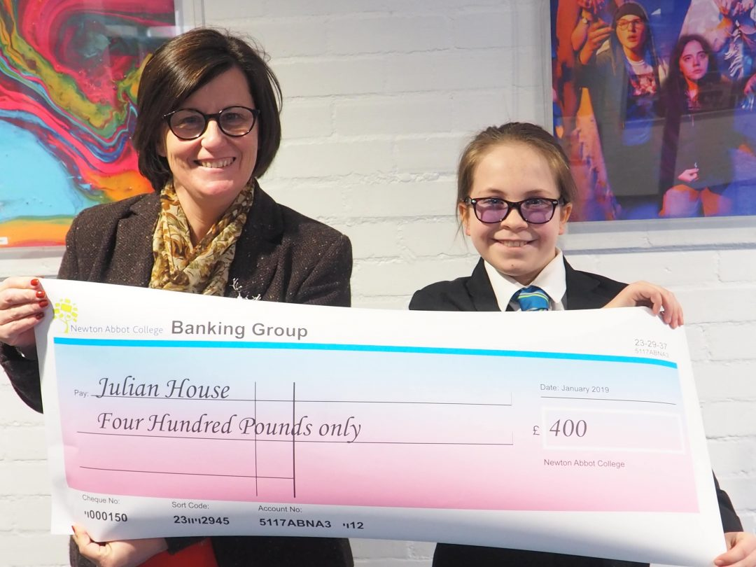 Head of House Tracy Dommett with Malika and her generous donation