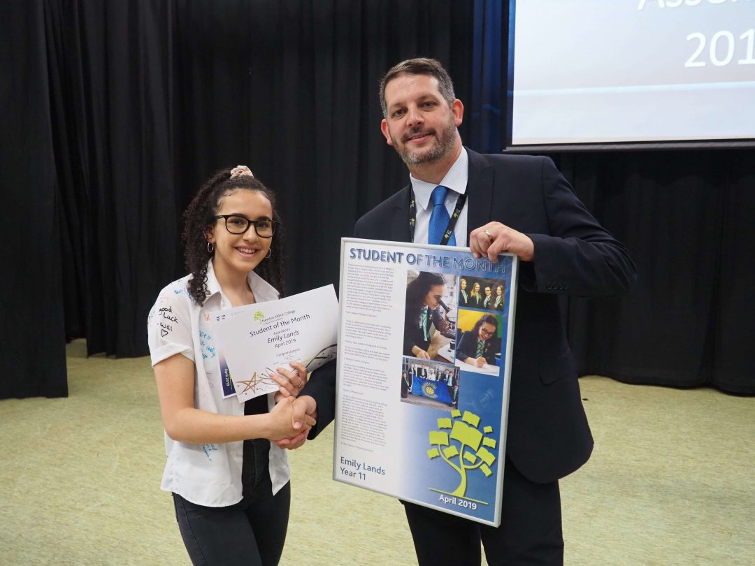 Emily collecting her award from Mr Cornish at her Year 11 leavers' assembly
