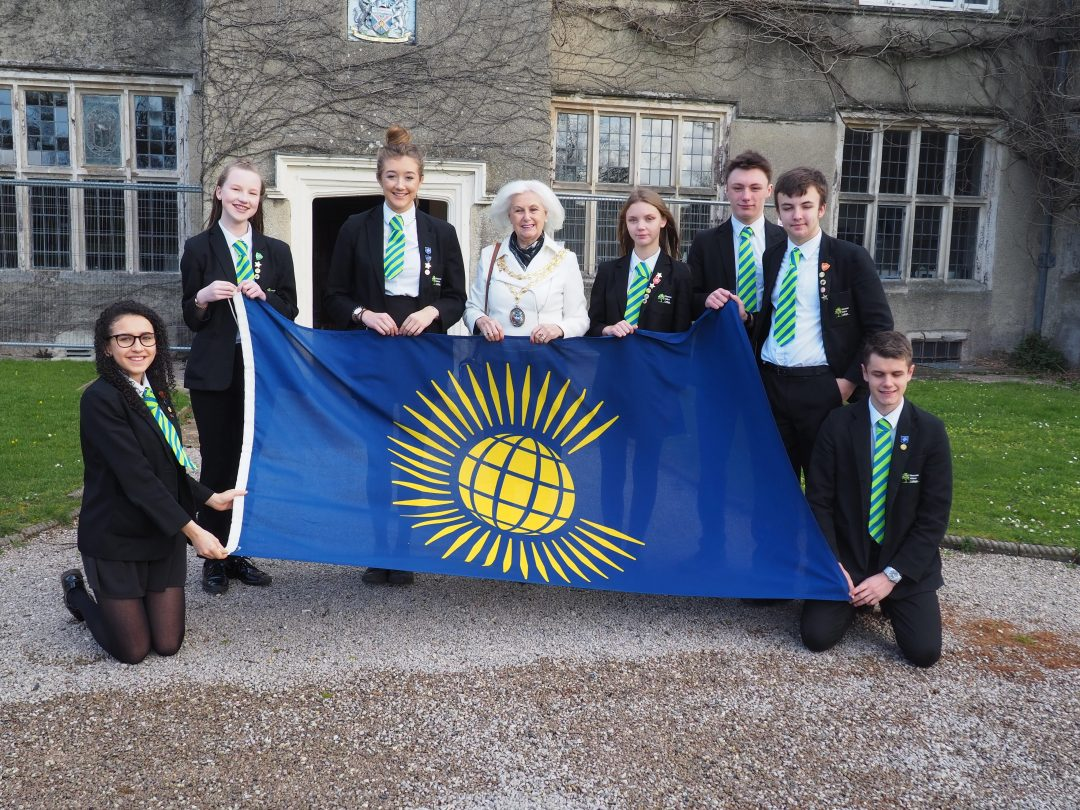 Prefects with Cllr Avril Kerswell and the Commonwealth Flag