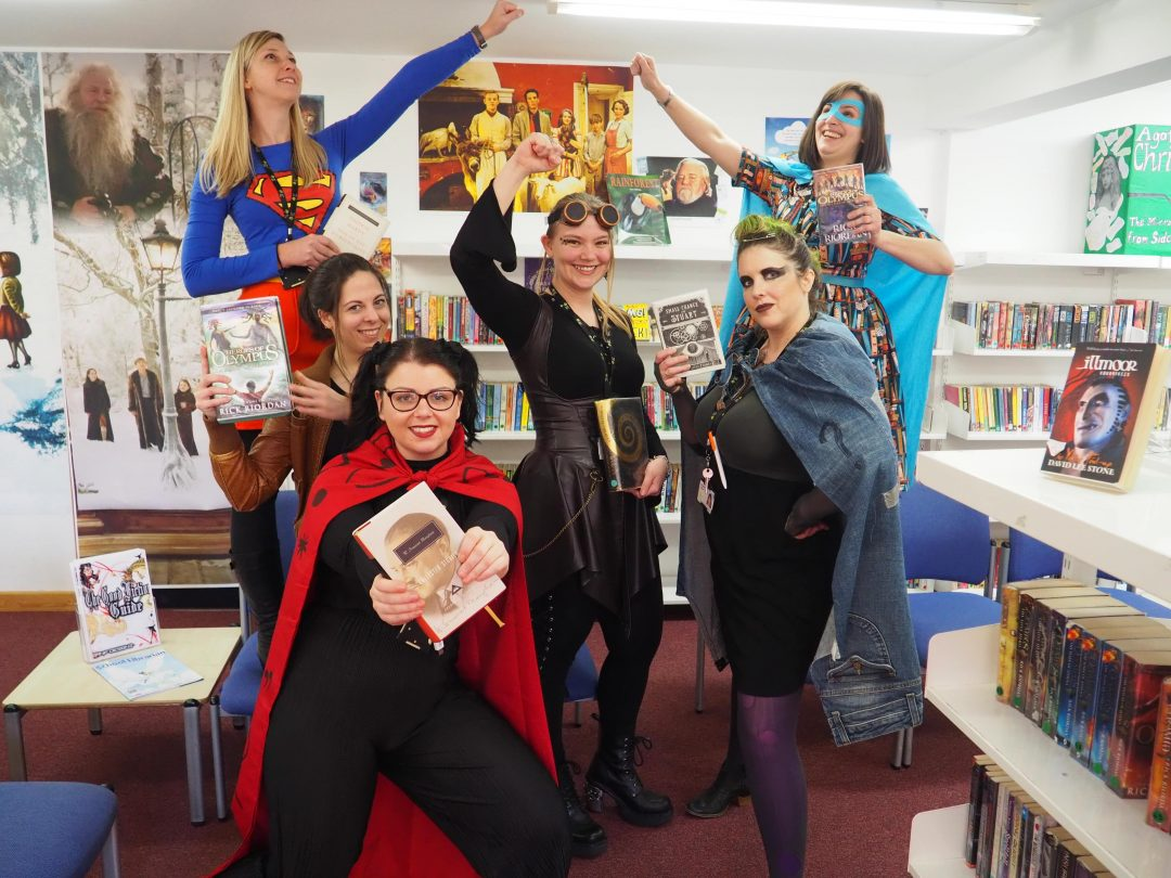 The English Department dressed as literary superheroes for the day