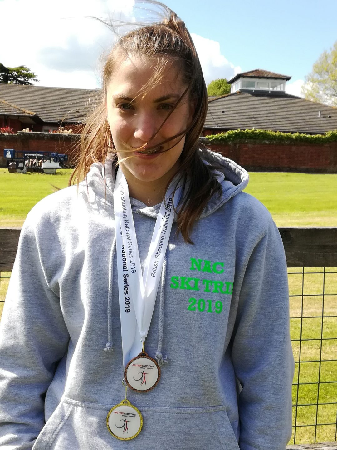 Erin with her most recent medal haul