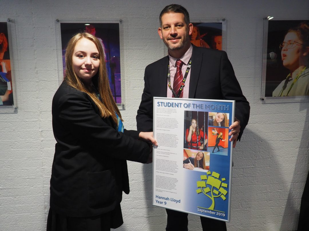 Hannah receiving her award from Mr Cornish