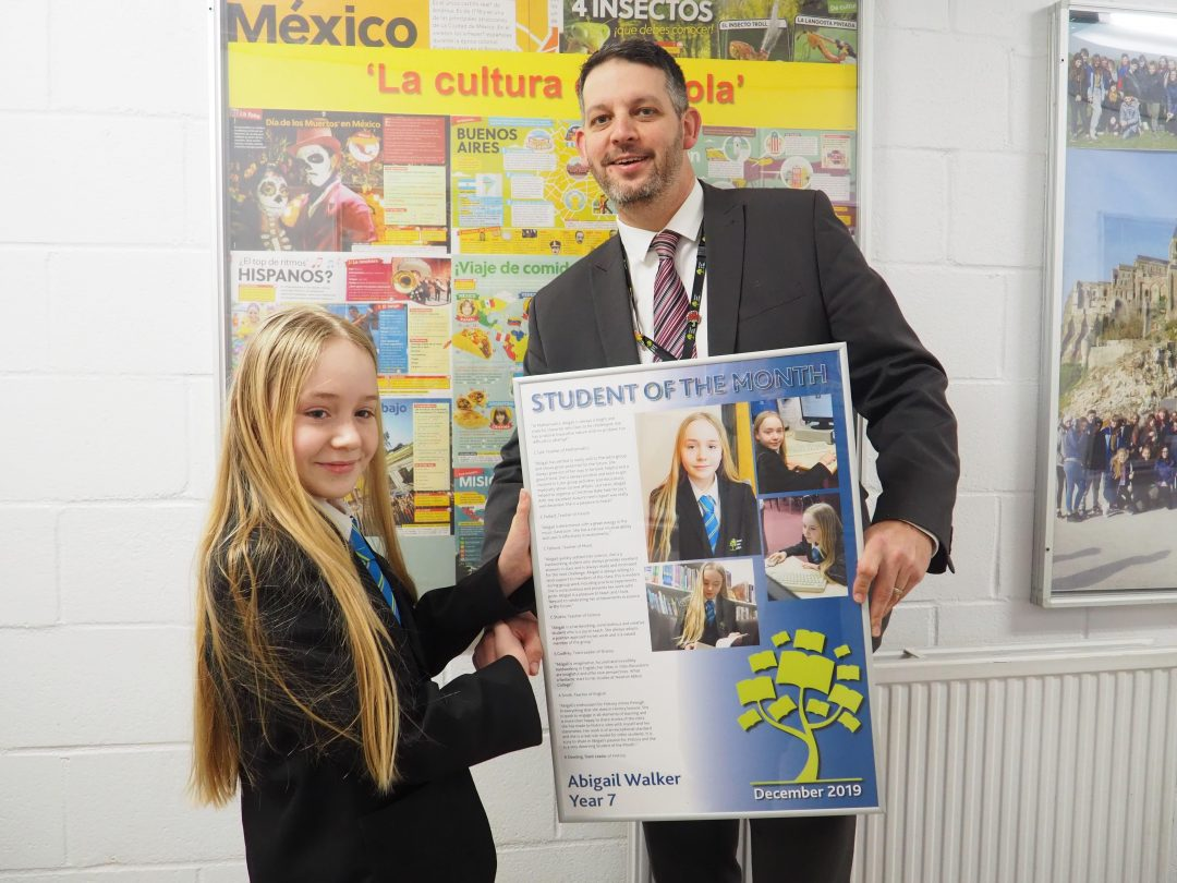 Abigail receiving her award from Mr Cornish
