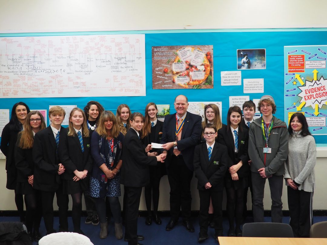 Eco Council members received a cheque from the Rotary Club of Newton Abbot