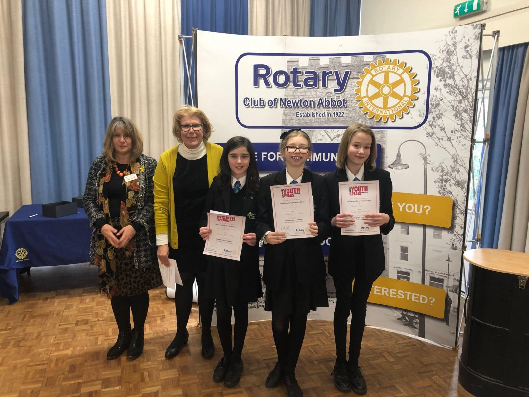 L-R Olivia Knibb, Sallie Monaghan and Matilda Slee with representatives from Newton Abbot Rotary Club