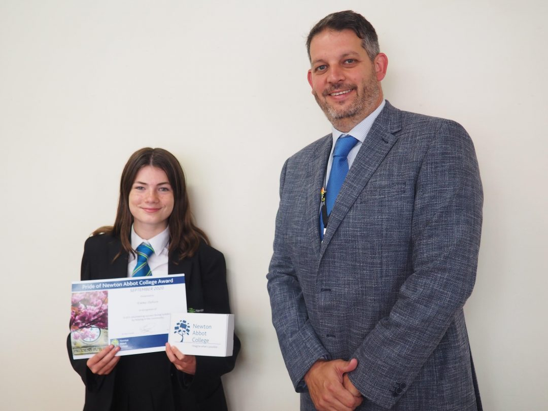 Emma Dobson receiving her award from Mr Cornish